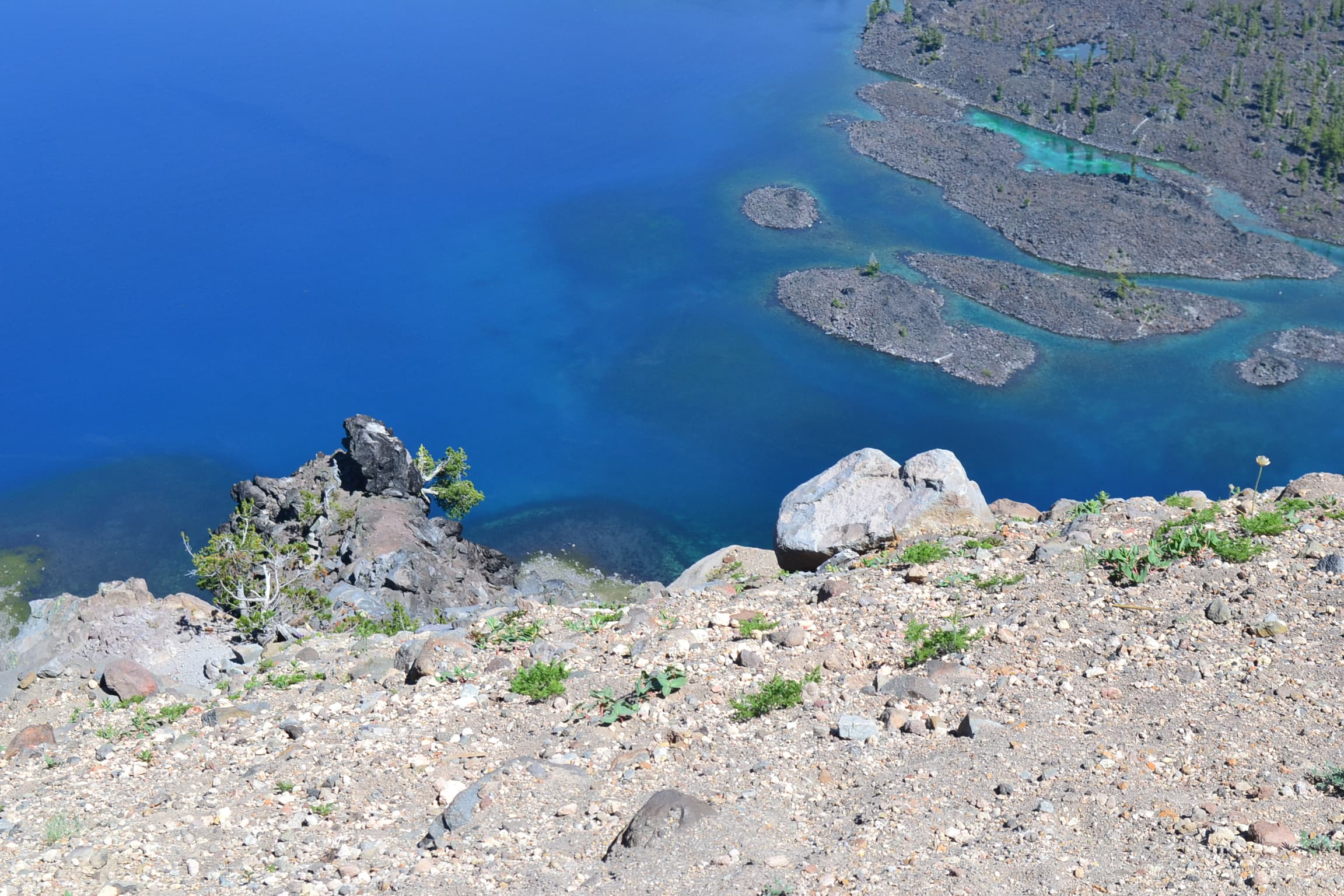View of down the side of Crater Lake from above.